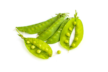 young fresh pods of green peas isolated on white background
