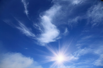 summer blue sky with sun and clouds