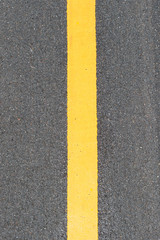Road texture with yellow stripe