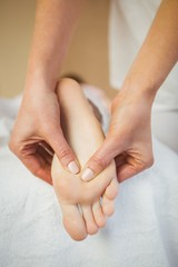 Young woman getting foot massage