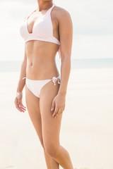 Fit woman in white bikini