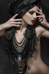 Beauty portrait of woman with creative makeup and black necklace