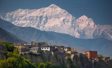 Fototapeta Rural life in front of Incredible Himalayas.  Nepal, ACAP, Upper Mustang, Kagbeni village (2,810 m) and Nilgiri North (7,061 m) obraz