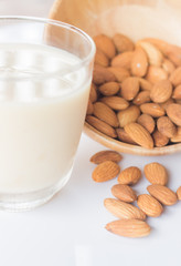 Almond milk and grain on white kitchen table
