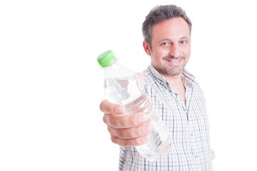 Man offering, giving a bottle of cold water