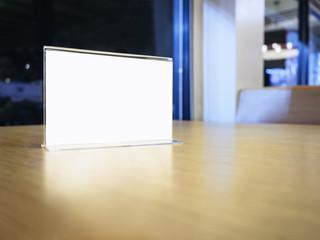 Mock up Menu frame on Table in Restaurant Cafe shop