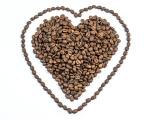 Coffee beans in heart shape with line around heart on white back