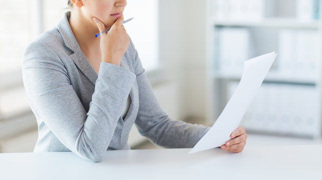 close up of woman reading papers or tax report