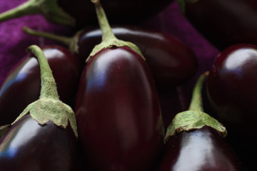 A closeup view of several fresh eggplants