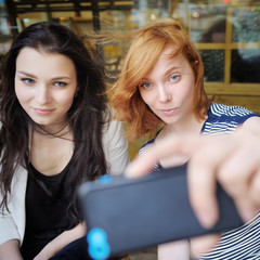 Two young girls taking a self portrait