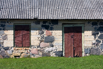 Wall of the rural house with door and window