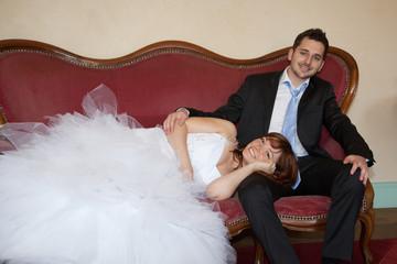 Young wedding couple on a vintage sofa