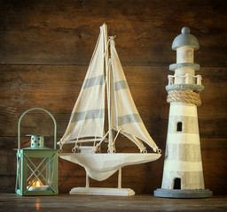 nautical lifestyle concept. old vintage lighthouse, sailing boat