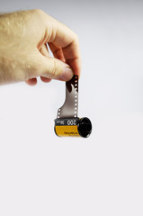 Film camera roll 35 in man's hand