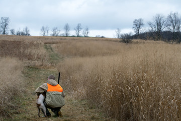 Young Man and Bird Dog Hunting Companion