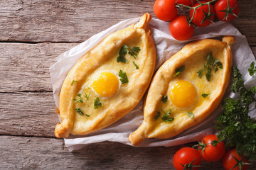 Adjarian khachapuri and vegetables horizontal top view