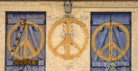 Peace sign repeated symbol on abandoned building