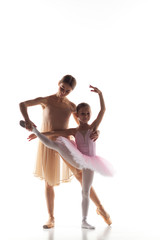 The little ballerina dancing with personal ballet teacher in