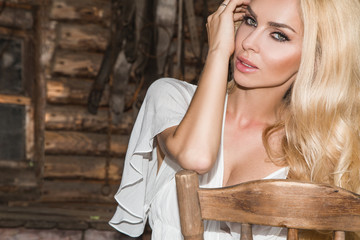 Beautiful blond woman with long hair pretty sexy eyes and mouth on the wild west