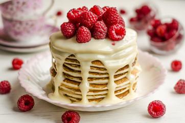 Pancake with sauce and raspberries