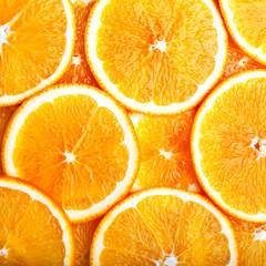 Orange slices background close up