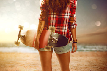 Woman with longboard at the beach