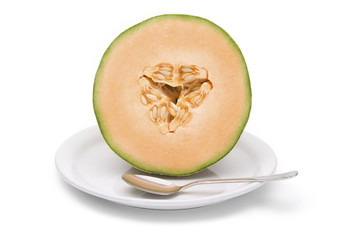 Cantaloupe Half on Plate – A half of a fresh cantaloupe, on a white plate with a spoon. White background.