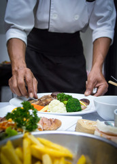 Chef apply  and arrange to food i