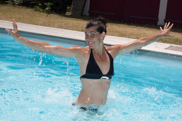 Happy woman in a swimming pool