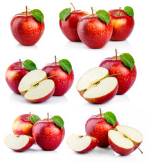 Set of ripe red apples with green leaves isolated