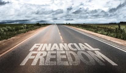 Financial Freedom written on rural road Wall mural