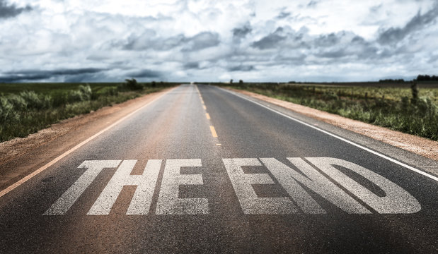 The End written on rural road