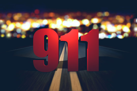 911 emergency number standing on the road
