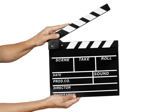 young man with a traditional wooden clapperboard