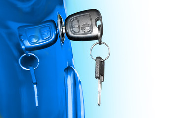 Key at car doors. Closeup with shallow DOF. Picture with space for your text.