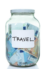Glass jar full of Euro currency for travel