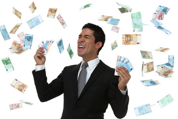 Businessman celebrating in a money rain storm