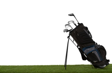 Golf bag and clubs on grass side view isolated on white
