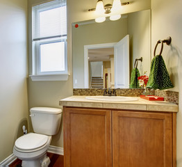 Small half bathroom with nice decor.
