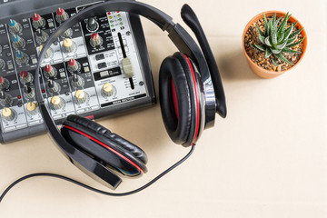 sound mixing console with old headphones