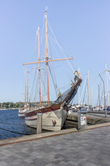 sailboat / Wooden sailboat moored in the harbor on