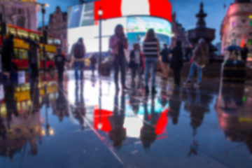 Defocused blur of lights, people and reflections at night in Piccadilly Circus, London