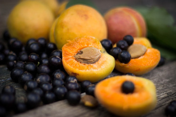 fresh apricots, black currant in a glass bowl transparent scatte