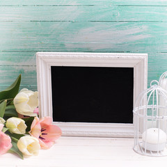 Background with flowers, empty blackboard and candles