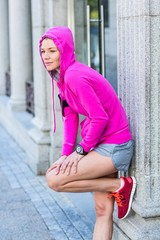 A woman wearing a pink jacket