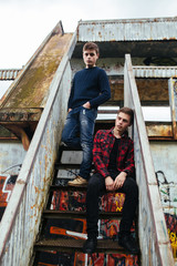 two guys stand in an abandoned building