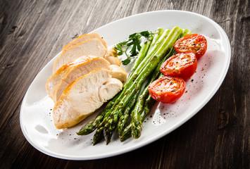 Roast chicken fillets and vegetables