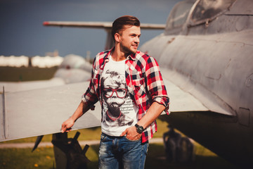 stylish man in shirt and jeans outdoors