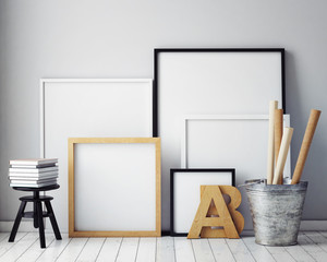 mock up poster frames in hipster interior