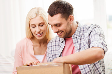 happy couple with parcel box at home